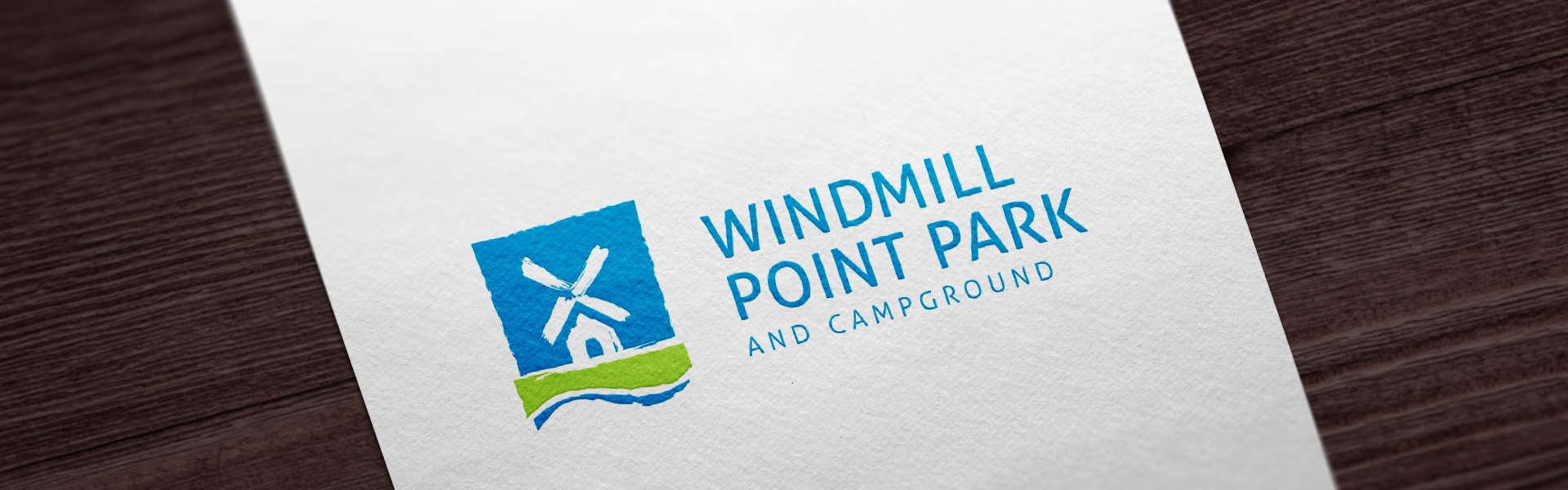 Windmill Point Park identity – stylized windmill with text